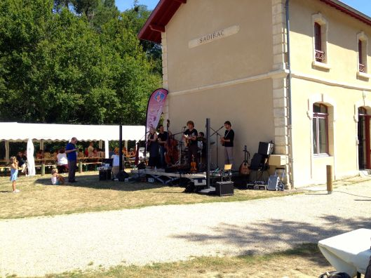 A local band plays at a wine maker's fair in Bordeaux